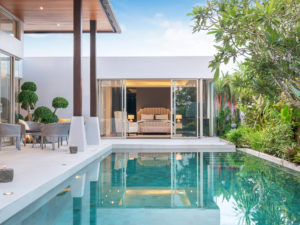 a white modern house with a pool