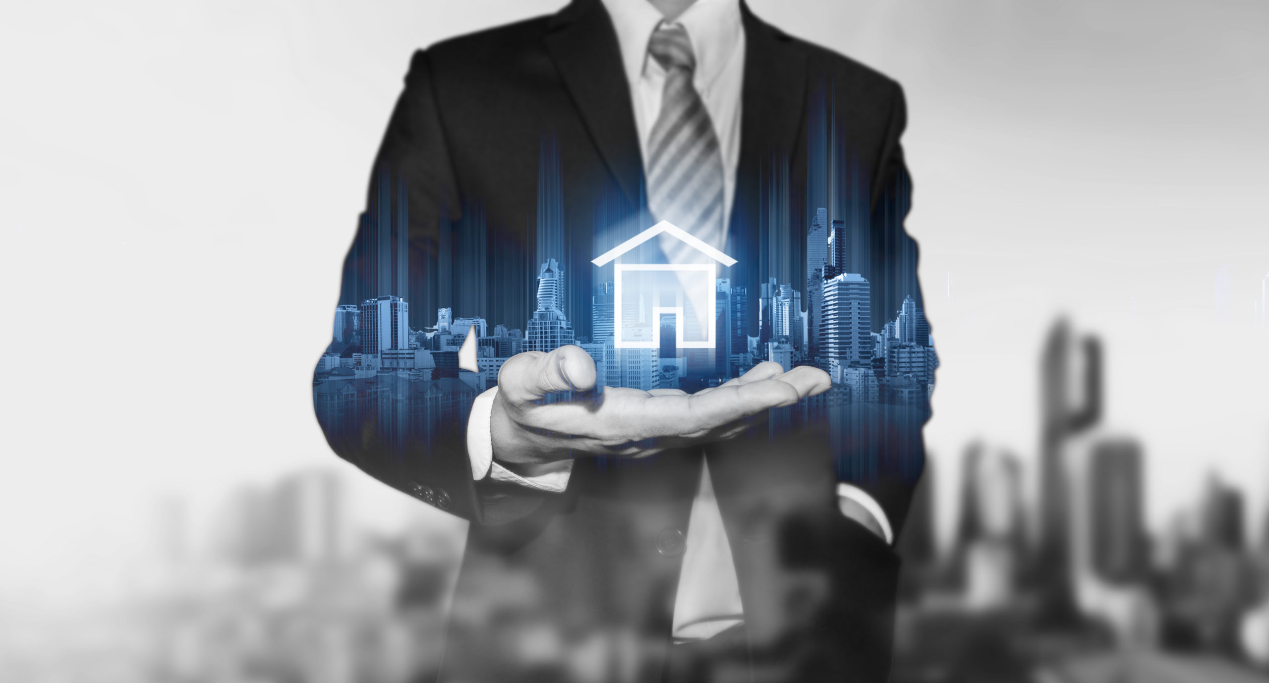 a graphic image of a man in a business suit with an icon of a house floating on his hand
