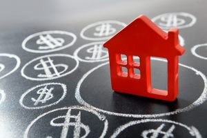 House figure and painted dollar symbols