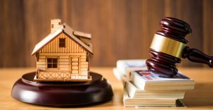 Gavel justice hammer and wood house on wood background