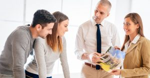 Young couple consult with two real estate agent